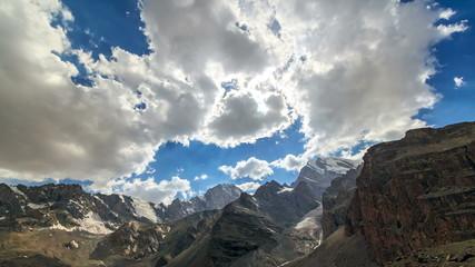 Sun illuminates the mountain valley. TimeLapse. Pamir, 4K