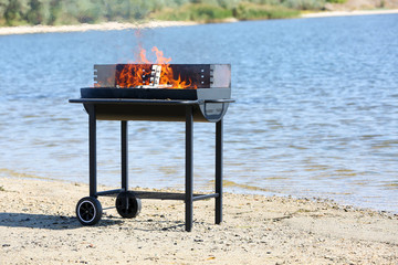 Barbecue grill on beach of river
