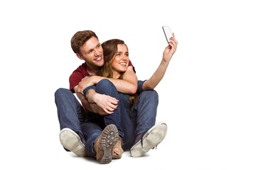 Young couple taking selfie with smart phone