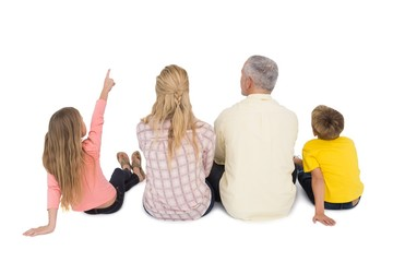 Happy family sitting and pointing