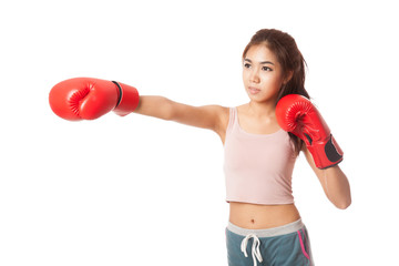 Asian slim girl punch with red  boxing glove