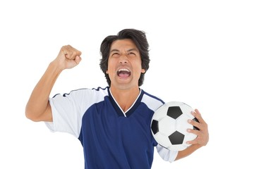 Athletic football player cheering