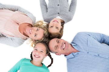 Overhead of smiling family lying together in a circle