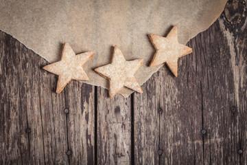 Sweet cookies in star shape on rustic wood