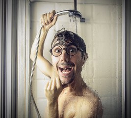 Surprised man under the shower