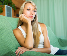 Blonde unhappy woman at home