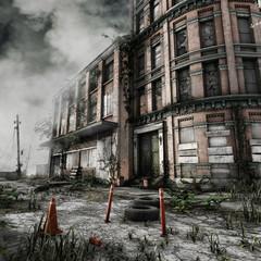 Opuszczony budynek miejski z zarośniętym trawą podwórzem