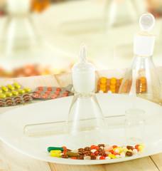 image of pills, vial and flasks closeup