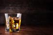 Leinwanddruck Bild - Glass of scotch whiskey and ice