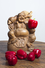 Buddha with red pepper