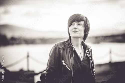 Young beautiful short hair woman at the embankment - 70932493