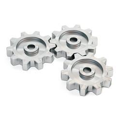 Three metal cog gears