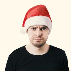 Sad face. Man with a santa hat, Color toned image.