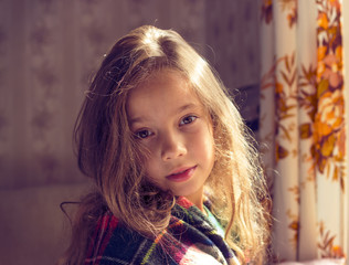 Adorable little girl awaked up in sunny morning