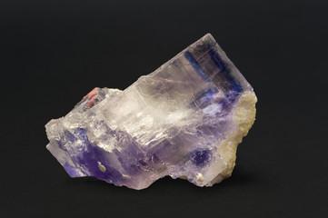 Rock salt (halite) with blue inclusion. 9cm across.