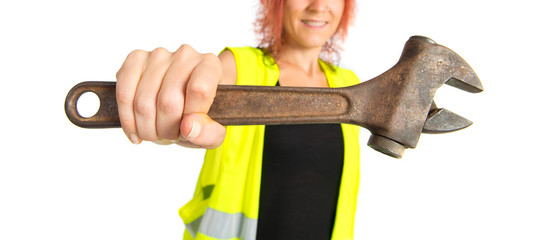 Worker woman with wrench over white background