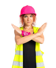 Worker woman making stop sign over white background