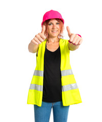 Worker woman making Ok sign over white background