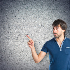 Man thinking over textured background