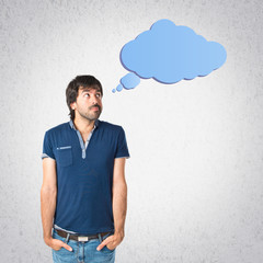 Man thinking over grey background