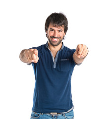 Man pointing to the front over white background