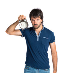 Man holding a clock over white background