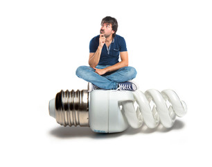 Man thinking on bulb over white background