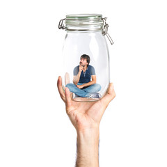 Man thinking inside jar glass