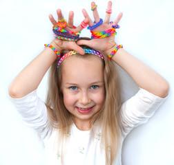 Little girl demonstrating her cruft works, Loom bangs
