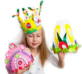 Little girl demonstrating her cruft work Easter bonnets
