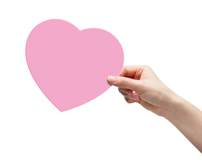 Hand picking pink paper heart