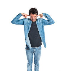 Man covering his ears over white background