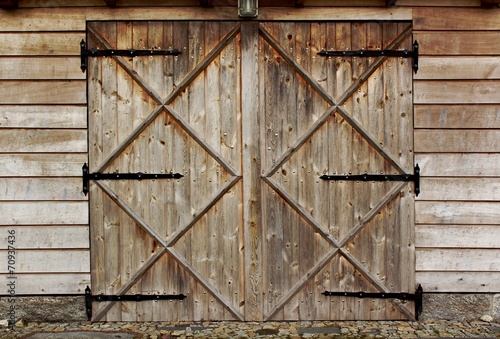 old barn wooden door with four crosses - 70937436
