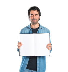 Man showing book over white background