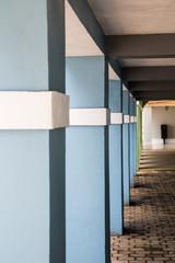 White Trim on Blue Plaster Columns