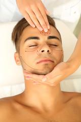 Face massage. Man having head massage (with arrows)