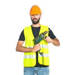 workman with drill over white background