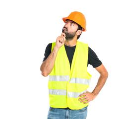 Workman thinking over isolated white background