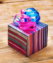 box wrapped with a bow on wooden background