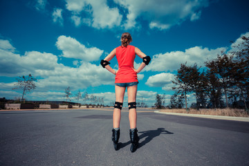 Young woman rollerblading