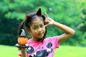 Close up portrait of Asian girl hold pumpkin doll