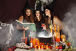Witches look into the book