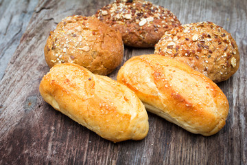 bread and rolls on wood