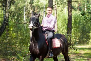 handsome man on horse