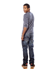 worried dark-skinned young man in jeans and blouse