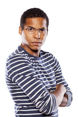 angry dark-skinned young man with glasses and arms crossed