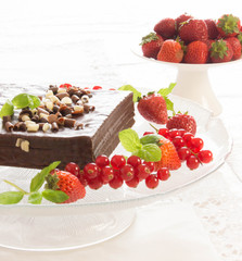 White and black chocolate cake with red berries