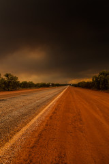 Bush fire in the Outback Australia from a highway point of view