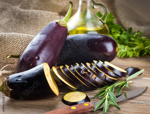 Eggplant and olive oil on a wooden board - 70944646