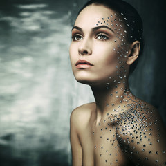 beautiful young girl with crystals on the body